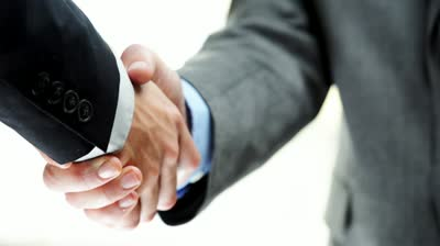 stock-footage-businessmen-shaking-hands-business-deal-partnership-high-definition